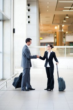 Business travellers meeting at airport