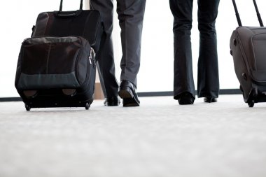 Business travellers walking in airport