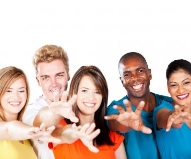Group of multiracial friends reaching for the camera