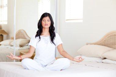 Beautiful young woman practicing yoga meditation