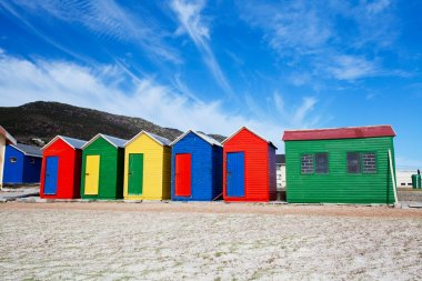 Colorful beach cottages in Cape Town