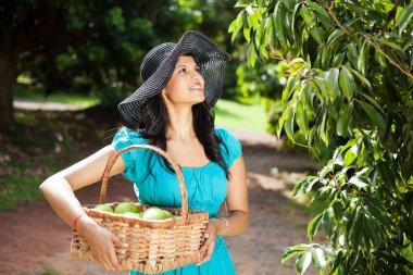 Pretty woman in furit garden