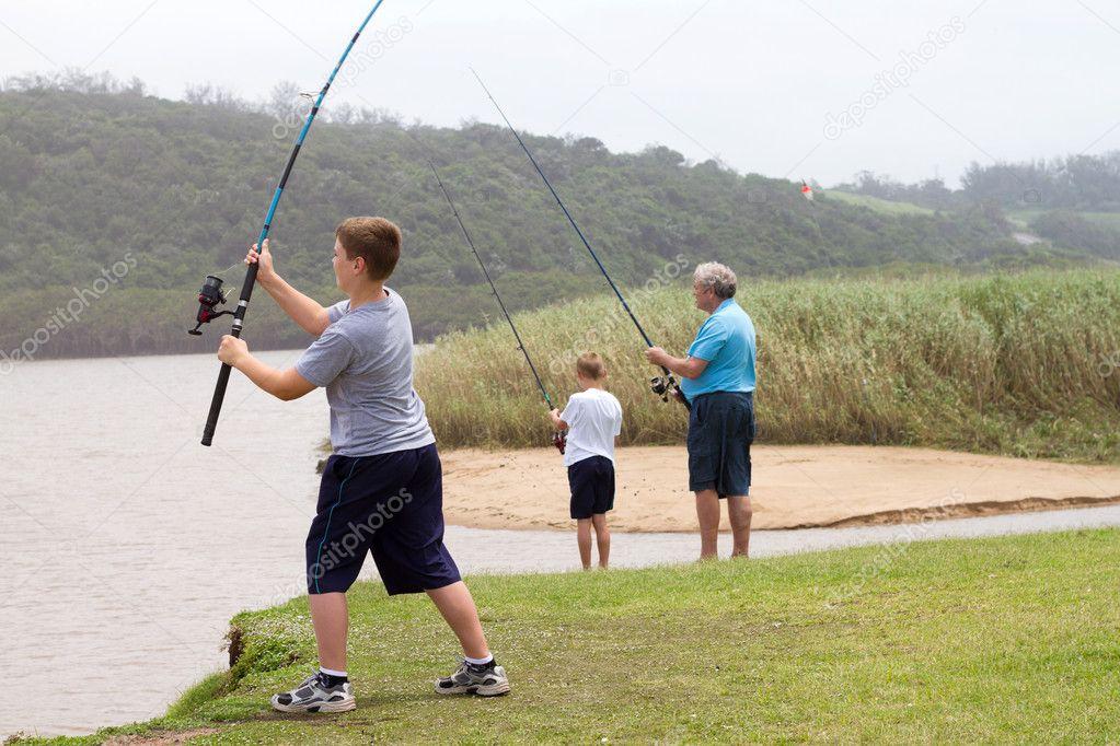Teen boy casting a fishing rod
