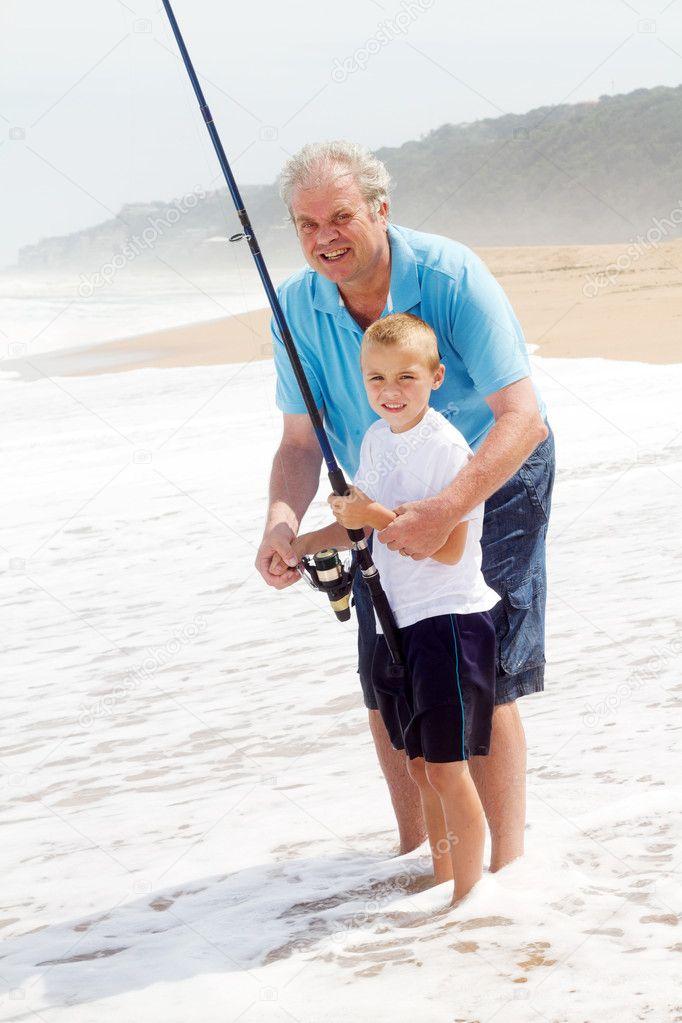 Grandpa teaching grandson fishing