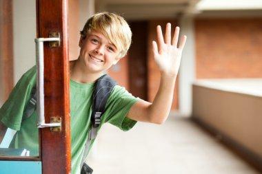 High school boy waving good bye