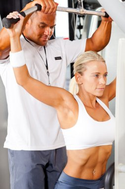 Fitness woman and personal trainer