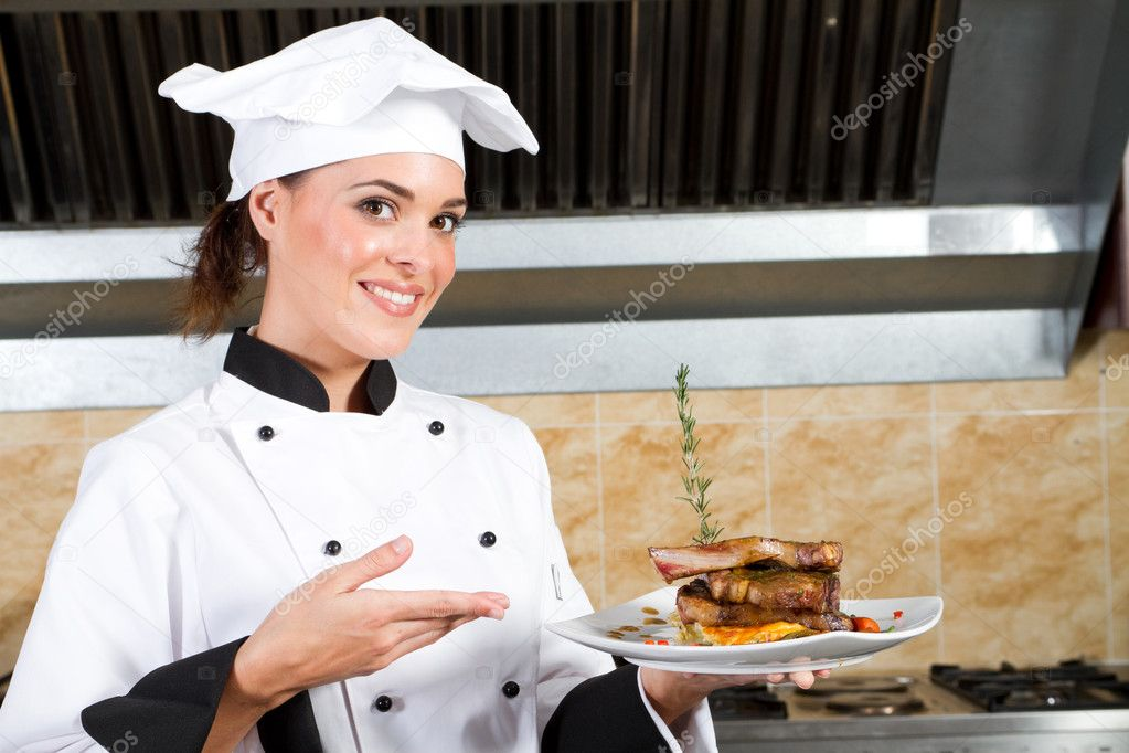 Young beautiful female chef presenting food — Stock Photo ...