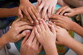 Fotografie Diversity kids hands together on globe