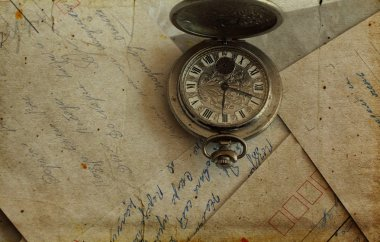 Antique pocket watches and old postcards