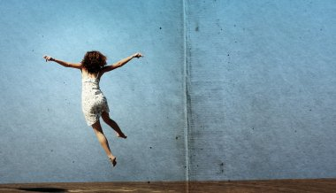 Funny jump of young woman. freedom.