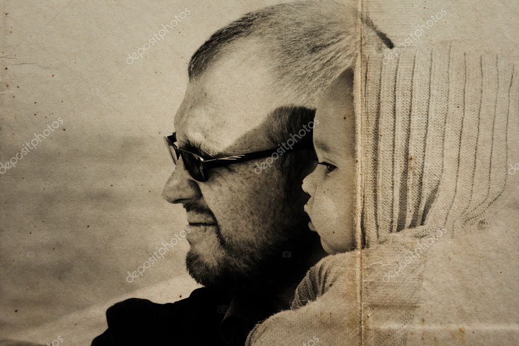 Portrait of 10 month old girl and dad. Focus on the child.