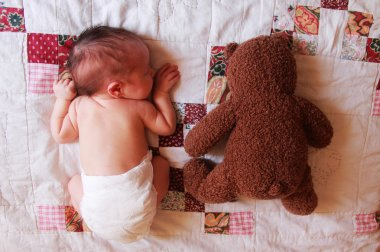 5 days old baby with toy