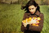 Mädchen mit Orangen