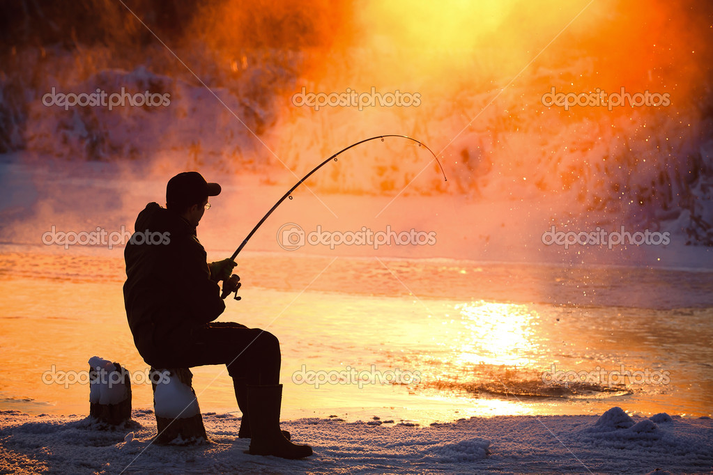 Fishing in the winter on not frozen reservoir