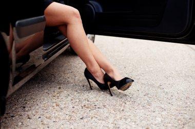 Sexy legs alighting from car