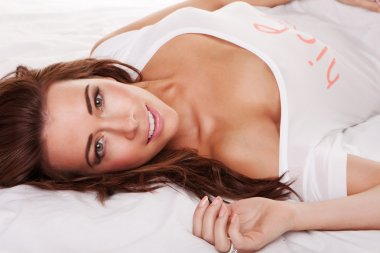 Beautiful Young Woman On Bed