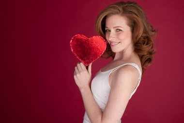 Pretty Woman Holding Red Heart