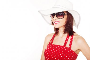 Smiling female with hat and sunglasses
