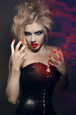 Portrait of young gothic girl with red lips and nails