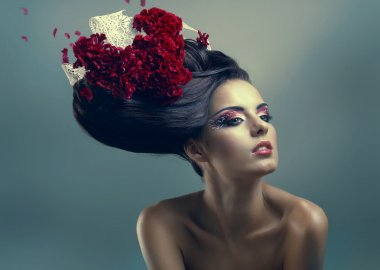 Woman with creative hairstyle with flowers