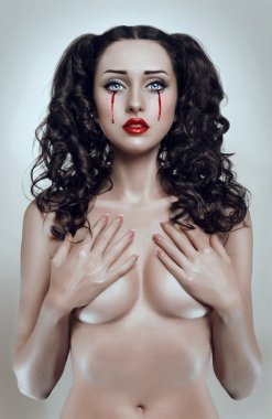 Beautiful brunette bleeding woman