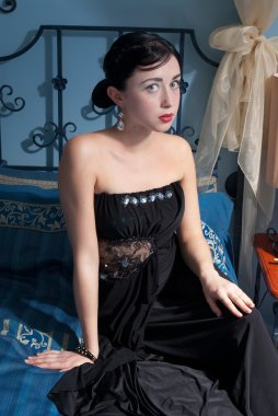 Attracting woman in black dress
