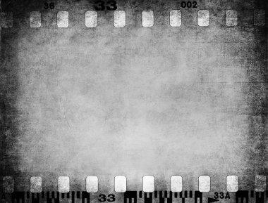 Grunge color filmstrip texture, scratched photo film frame background