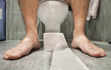 A man sitting on toilet