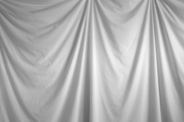 White draped backdrop