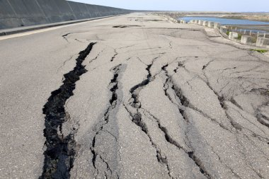 Collapse and cracked road