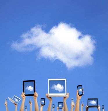 Cloud computing concept.hands holding computer laptop smart phone tablet and touch pad