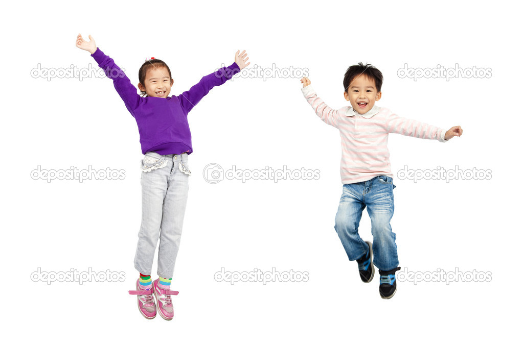 Happy boy and girl jumping together