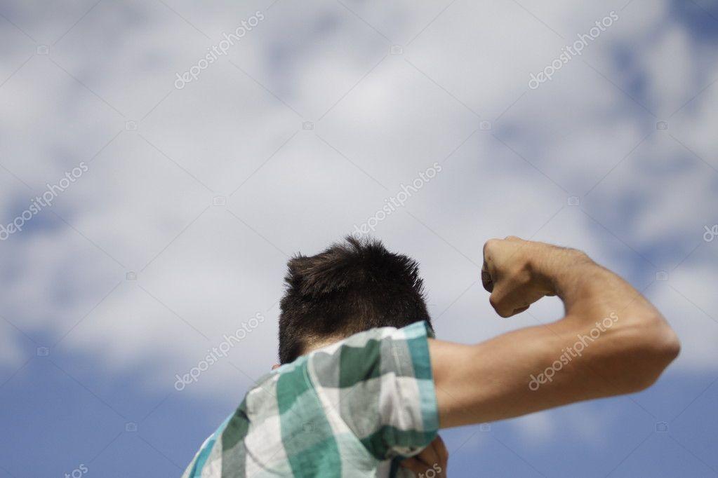 Teen zeigt den Muskel des Armes — Stockfoto © ciumari63 #10665482