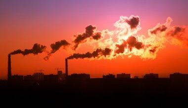 Exhaust smoke / Air pollution / Sunrise / Silhuette