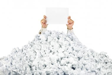 Person under crumpled pile of papers with a blank page / isolate