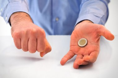 Man playing with euro coin.