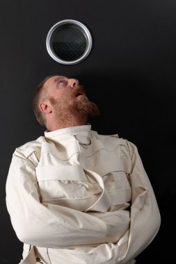 Paranoid man in a straitjacket