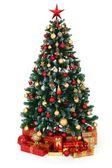 Fényképek zöld díszített karácsonyfa és az ajándékok