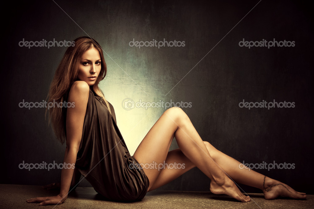 Young woman in elegant short dress sit barefoot, full body shot, studio shot stock vector