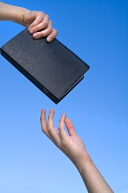 Hand Giving the Bible