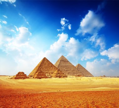 Giza valley with Great pyramids with blue cloudy sky stock vector