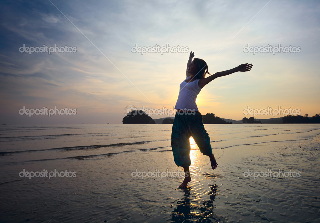 Young woman with raised hands