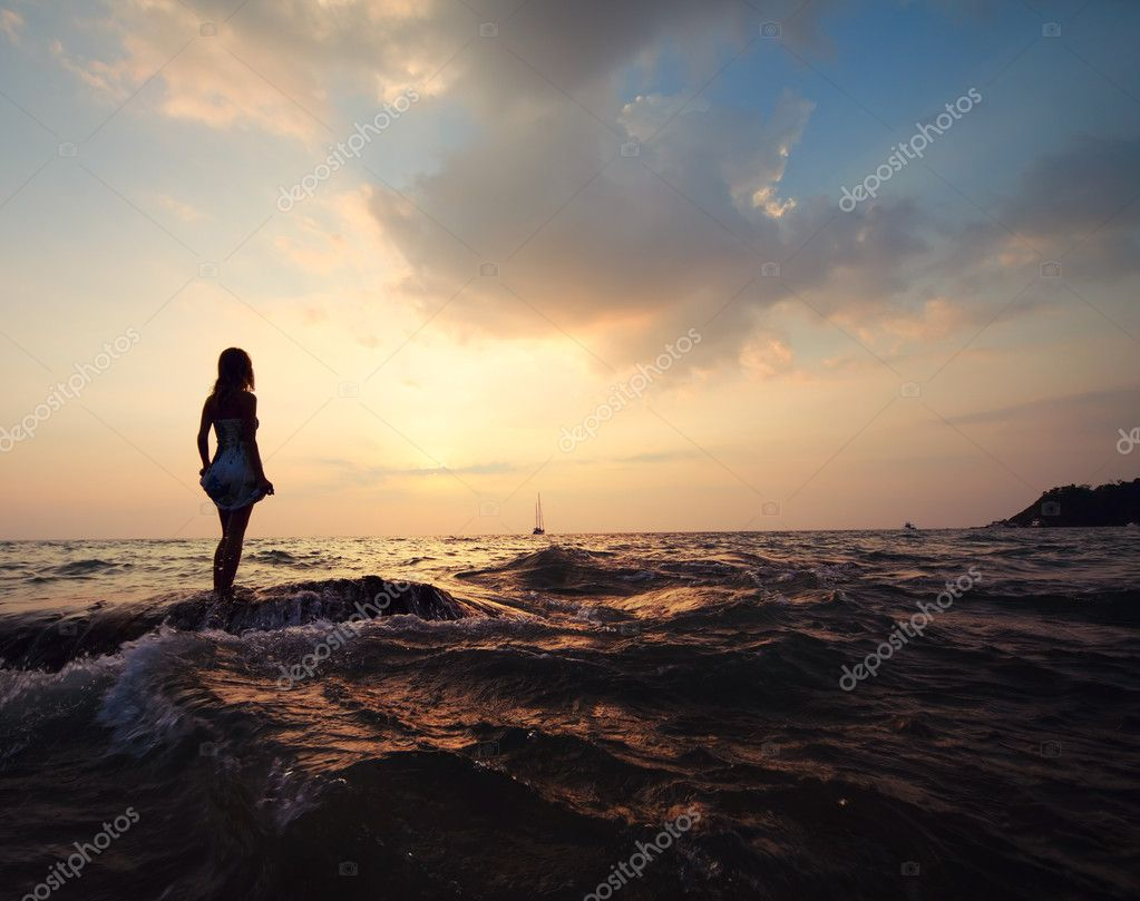 Woman silhouette at the seaside