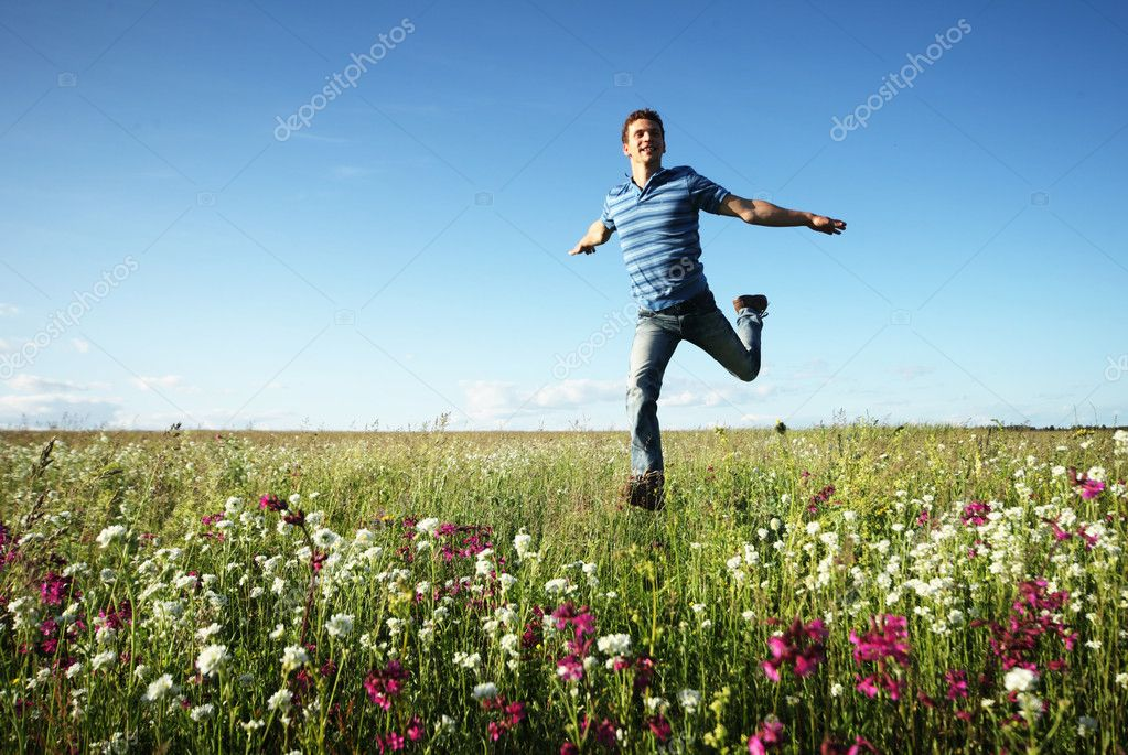 Man running on meadow