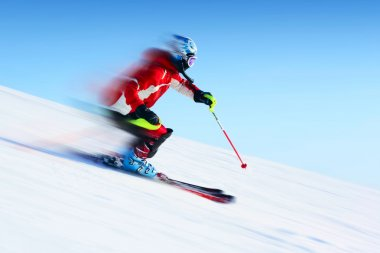 Ski rider in motion. Blurred back and sharp front stock vector