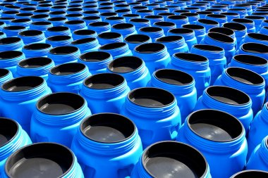 The blue plastic barrels for storage of chemicals