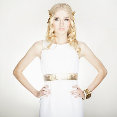 Portrait of beautiful blondie woman greek styled. isolated on wh