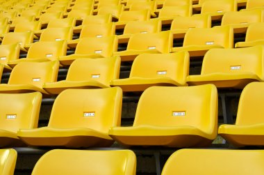 Yellow Empty plastic seats at stadium