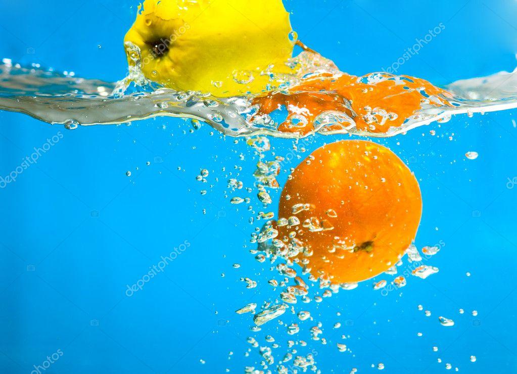 YELLOW APPLE AND CITRUS SPLASHING IN WATER