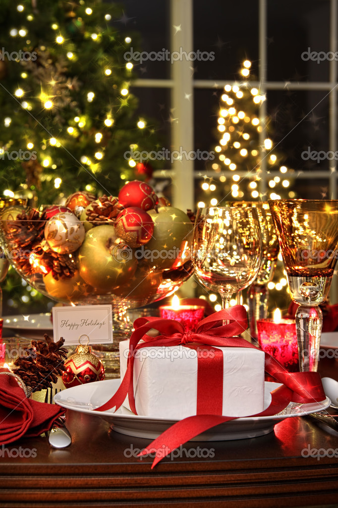Festive table setting with red ribbon gift